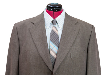sartorial: business suit on tailor mannequin - green woolen jacket with shirt and tie close up isolated on white background