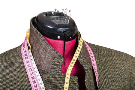 sartorial: tailoring of man tweed jacket on dummy isolated on white background