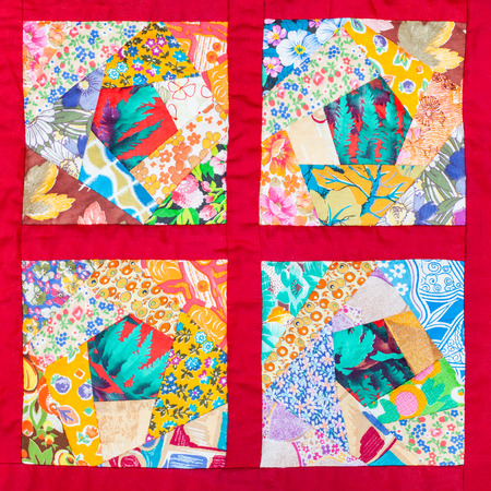 patchwork quilt: four details of hand made patchwork quilt in red fabric framing