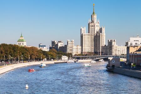 kotelnicheskaya embankment: Moscow skyline - Moskva River and Moskvoretskaya Embankment, Raushskaya quay, Bolshoy Ustinsky Bridge and Kotelnicheskaya Embankment High-Rise Building in Moscow, Russia in sunny day