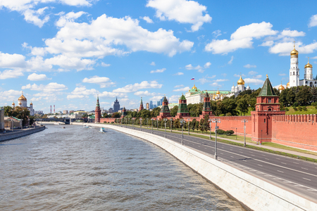 moskva river: Moscow skyline - Kremlin embankment along Moskva River and Kremlin Cathedrals in Moscow in sunny smmer day Editorial