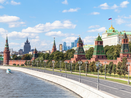 rive: Moscow cityscape - view of Red Walls and Towers of Moscow Kremlin on Kremlin Embankment of Moskva Rive in Moscow, Russia in summer day
