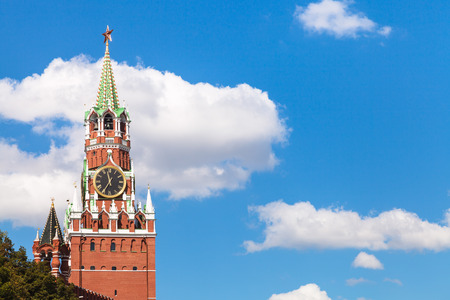 spasskaya: Spasskaya clock Tower of Moscow Kremlin and white clouds in blue sky in sunny summer day