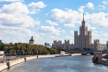 kotelnicheskaya embankment: Moscow skyline - view of Moskvoretskaya Embankment of Moskva River, Bolshoy Ustinsky Bridge and Kotelnicheskaya Embankment High-Rise Building in Moscow, Russia in summer day