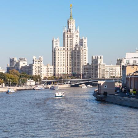 kotelnicheskaya embankment: Moscow cityscape - view of Moskva River and Moskvoretskaya Embankment, Raushskaya quay, Bolshoy Ustinsky Bridge and Kotelnicheskaya Embankment High-Rise Building in Moscow, Russia in sunny day
