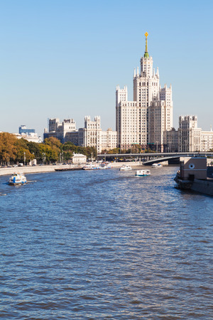 kotelnicheskaya embankment: Moscow cityscape - Moskva River and Moskvoretskaya Embankment, Bolshoy Ustinsky Bridge and Kotelnicheskaya Embankment High-Rise Building in Moscow, Russia in sunny day