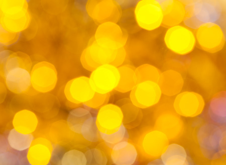 strings: abstract blurred background - yellow shimmering Christmas lights bokeh of electric garlands on Xmas tree