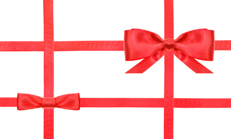 cross ties: red satin bow and knot and four intersecting ribbons isolated on horizontal white background