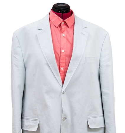 sartorial: casual suit on tailor mannequin - blue cotton jacket with red shirt isolated on white background Stock Photo