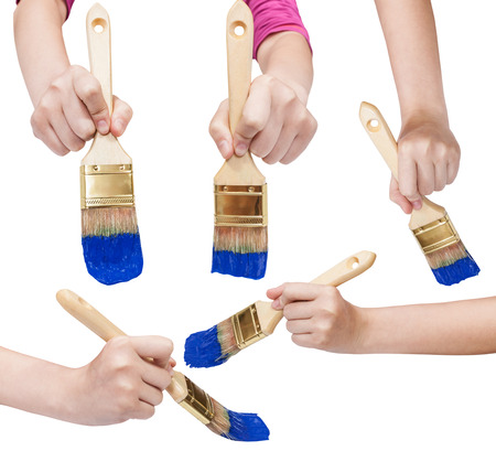 flat brushes: set of painter hands with flat paint brushes with blue painted tips isolated on white background