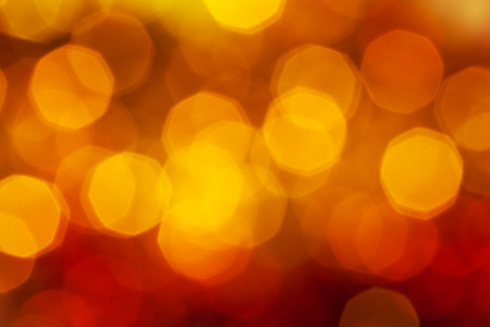 agleam: abstract blurred background - big dark red, yellow, brown shimmering Xmas lights bokeh of garlands on Christmas tree Stock Photo