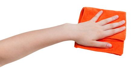 on a white background: hand with orange dusting rag isolated on white background Stock Photo