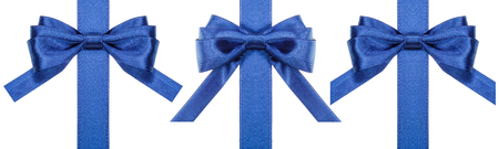 bow: set of silk blue bows on vertical ribbons isolated on white background Stock Photo