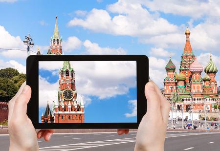 spasskaya: travel concept - tourist photographs picture of Spasskaya Tower of Moscow Kremlin from Bolshoy Moskvoretsky bridge on tablet pc Stock Photo