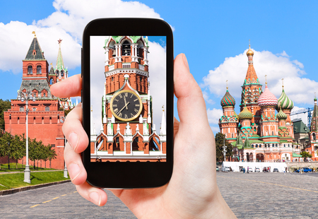 spasskaya: travel concept - tourist photographs picture of Spasskaya Tower and Red Square of Moscow Kremlin on smartphone Stock Photo