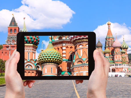 pokrovsky: travel concept - tourist photographs picture of Pokrovsky Cathedral on Vasilevsky Descent of Red Square in Moscow Kremlin on tablet pc