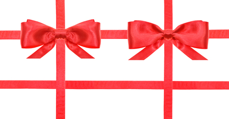 ribbon: two red satin bows upper and four intersecting ribbons isolated on horizontal white background
