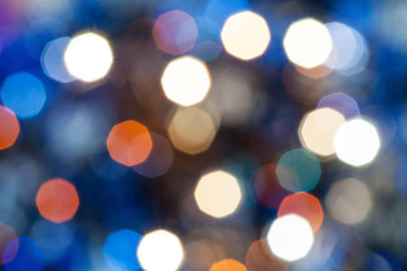 agleam: abstract blurred background - blue shimmering Christmas lights bokeh of electric garlands on Xmas tree Stock Photo