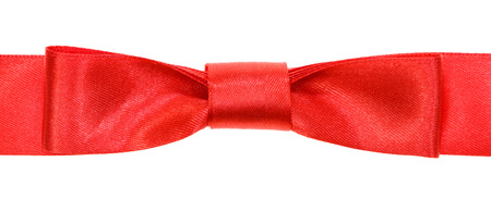 neckband: real red bow knot on wide satin tape isolated on white background Stock Photo