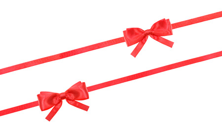 ribbon: two little red silk bows two diagonal ribbons isolated on horizontal white background