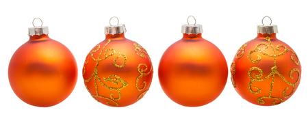 xmas background: christmas decorations - four orange xmas balls isolated on white background
