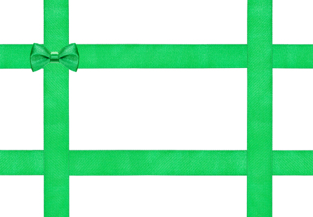 four in one: one little green bow knot on four satin ribbons isolated on white background