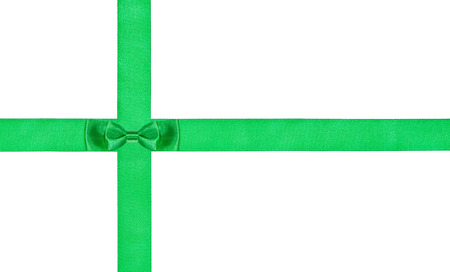 bow knot: one double little green bow-knot on two satin ribbons isolated on white background Stock Photo