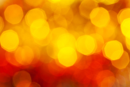 agleam: abstract blurred background - big red and yellow twinkling Xmas lights bokeh of garlands on Christmas tree Stock Photo