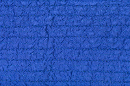 stitched: textile background from stitched wrinkled blue silk fabric