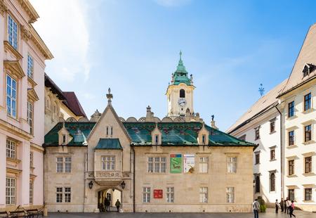 primates: BRATISLAVA, SLOVAKIA - SEPTEMBER 22, 2015: people near Bratislava City Museum (Muzeum mesta Bratislavy) on Primacialne namestie (Primates square). The Bratislava City Museum was established in 1868