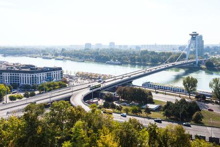uprising: BRATISLAVA, SLOVAKIA - SEPTEMBER 23, 2015: view of Most SNP (Bridge of the Slovak National Uprising, Novy most, New Bridge) bridge and Danube river in Bratislava. The bridge was constructed in 1972 Editorial