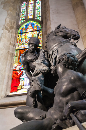 hussar: BRATISLAVA, SLOVAKIA - SEPTEMBER 23, 2015: Statue of St Martin in Hungarian hussar dress in St.Martins Cathedral. The Saint is dividing his cloak to give part to a beggar as protection from the cold Editorial