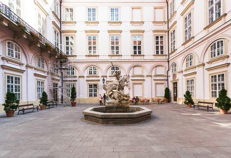 primates: BRATISLAVA, SLOVAKIA - SEPTEMBER 23, 2015: people and Fountain of St. George in the courtyard of Primates palace in Bratislava. The Palace was built from 1778 to 1781 for Archbishop Jozsef Batthyany.