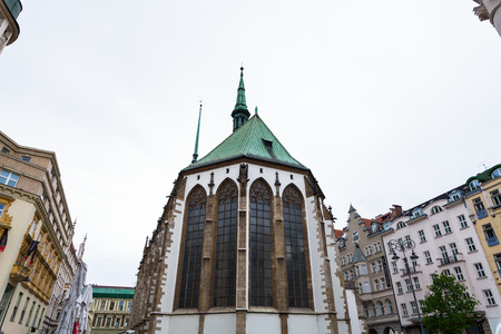 st german: BRNO, CZECH - SEPTEMBER 25, 2015: building of Church of St Jacob (St James) at James square (Jakubske namesti) in Brno. The church was founded for German inhabitants in the 13th century