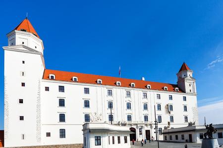 main gate: BRATISLAVA, SLOVAKIA - SEPTEMBER 23, 2015: tourists near Main gate of Bratislava castle. Bratislava Castle is the main ancient castle of Bratislava, it stands directly above the Danube river
