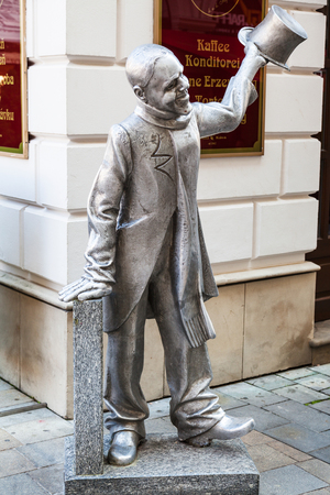 nicknamed: BRATISLAVA, SLOVAKIA - SEPTEMBER 23, 2015: Cast iron sculpture of Ignac Lamar, nicknamed Schoner Naci. Author of this sculpture is Juraj Melus and it was installed in June 1997
