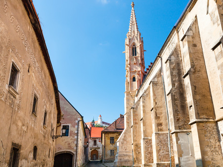 nuns: travel to Bratislava city - medieval houses, Convent of the Order of St Clare Nuns (Poor Clares) on Farska street and Castle on hill in Bratislava