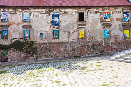 neglected: travel to Bratislava city - neglected house of the 17th century with mural paintings in windows at Rudnayovo namestie (square) in Bratislava