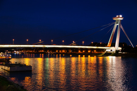 uprising: travel to Bratislava city - night illumination of Danube river from Most SNP Bridge of the Slovak National Uprising, UFO Bridge, Novy most, New Bridge in Bratislava