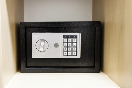 safe: compact safe on shelf of cabinet in hotel room Stock Photo