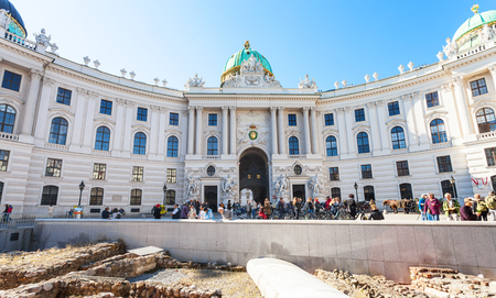 outpost: VIENNA, AUSTRIA - OCTOBER 1, 2015: ruin of ancient Roman military outpost in Vindobona celtic settlement on Michaelerplatz square and people near St. Michael wing of Hofburg Palace in Vienna Austria Editorial