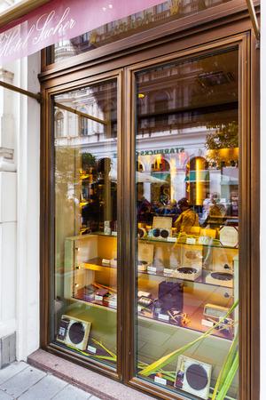 viennese: VIENNA, AUSTRIA - SEPTEMBER 27, 2015: Saher Hotel window with famous Sachertorte chocolate cakes. Sachertorte is one of the most famous Viennese culinary specialties invented by Franz Sacher in 1832