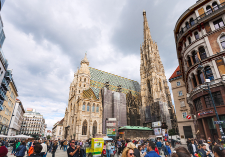 stephansplatz: VIENNA, AUSTRIA - SEPTEMBER 27, 2015: St Stephens Cathedral, tourist on Stephansplatz, Vienna, Austria. The Stephansplatz (Stephens Square) is a square at the geographical centre of Vienna Editorial