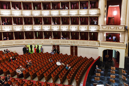 spectator: VIENNA, AUSTRIA - SEPTEMBER 28, 2015: spectator in hall of Vienna State Opera House. Wiener Staatsoper produces 50-70 operas and ballets in about 300 performance per year