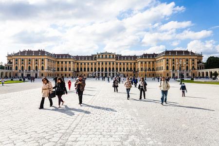 schloss schonbrunn: VIENNA, AUSTRIA - SEPTEMBER 29, 2015: tourists go from Schloss Schonbrunn palace to main entrance. Schonbrunn Palace is former imperial summer residence located Vienna city. Editorial