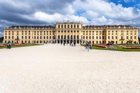 schloss schonbrunn: VIENNA, AUSTRIA - SEPTEMBER 29, 2015: tourists and front view of Schloss Schonbrunn palace. Schonbrunn Palace is former imperial summer residence located Vienna city.