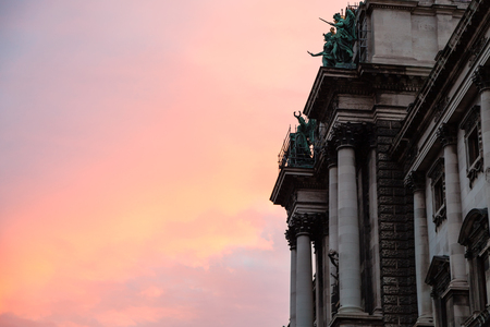 hofburg: travel to Vienna city - pink sunrise and Neue Burg of Hofburg Palace in Vienna,Austria Editorial