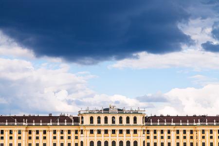 schloss schonbrunn: travel to Vienna city - dark storm cloud in blue sky over Schloss Schonbrunn palace, Vienna, Austria