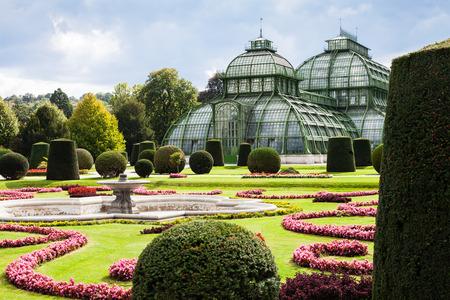 schloss schonbrunn: travel to Vienna city - Palmenhaus pavilion, large greenhouse in garden of Schloss Schonbrunn palace, Vienna, Austria Editorial