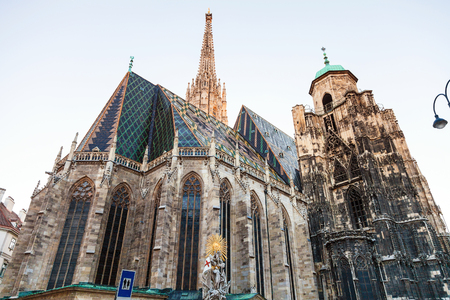 st  francis: travel to Vienna city - St. Francis statue and Stephansdom (St. Stephens cathedral), Vienna, Austria Stock Photo